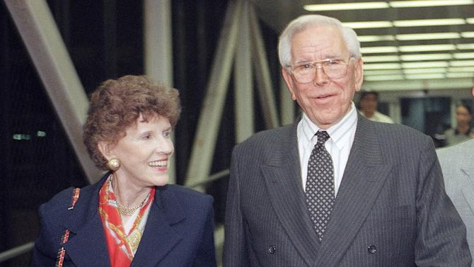 FILE - This Aug. 13, 1997 file phoe shows the Rev. Robert Schuller of the Crystal Cathedral, and his wife, Arvella at Los Angeles International Airport in Los Angeles.  Dr. and Mrs. Robert H. Schuller have announced Saturday March 10, 2012, their resignation from the board of directors of the Crystal Cathedral Ministries that they founded forty-two years ago, fifteen years after starting the Garden Grove Community Church.(AP Photo/John Hayes, File)