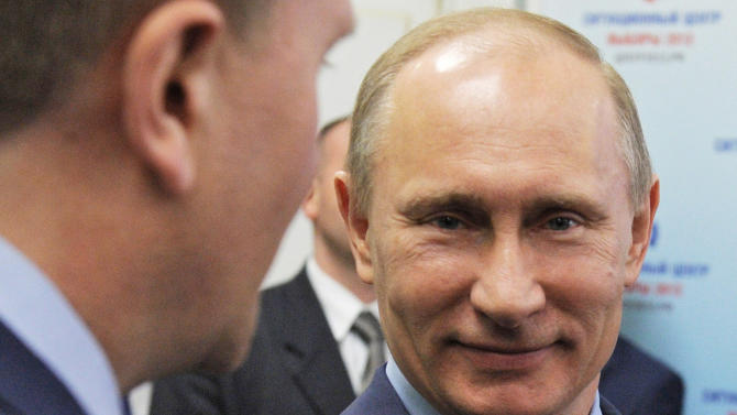 Russian Prime Minister Vladimir Putin visits the election monitoring center in Moscow, Tuesday, March 6, 2012. Putin won his third presidential term in Sunday's election. (AP Photo/RIA-Novosti, Yana Lapikova, Government Press Service)