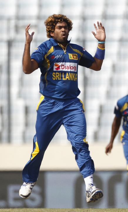Sri Lanka's Lasith Malinga reacts as he bowls against Pakistan during their Asia Cup 2014 final match in Dhaka