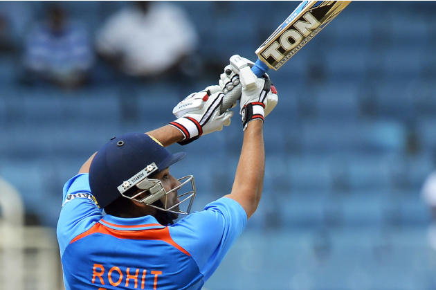 India's Rohit Sharma plays an uppercut during the one-day international cricket match against West Indies at Kingston, Jamaica, June 30, 2013.