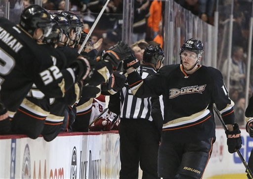 Anaheim Ducks right wing Corey Perry celebrates scoring during the first period of an NHL hockey game against the Phoenix Coyotes, Wednesday, March 6, 2013, in Anaheim, Calif. (AP Photo/Bret Hartman)