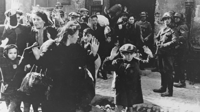 FILE- In this April 19, 1943 file photo, a group of Jews areescorted from the Warsaw Ghetto by German soldiers. After a year of tough negotiations, Germany agreed Monday, Dec. 5, 2011, to pay pensions to about 16,000 Holocaust victims worldwide who survived wartime ghettos or were forced to hide from Nazi persecution. (AP Photo, File)