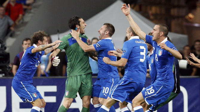 Italy's Alessandro Diamanti, left, and goalkeeper Gianluigi Buffon, second left, celebrate with teammates after winning the penalty shootout of the Euro 2012 soccer championship quarterfinal match between England and Italy in Kiev, Ukraine, Monday, June 25, 2012. (AP Photo/Michael Sohn)