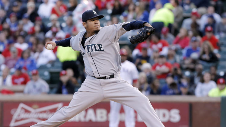 Seattle Mariners starting pitcher Felix Hernandez throws during the first inning of a baseball game against the Texas Rangers, Wednesday, April 16, 2014, in Arlington, Texas. (AP Photo/Brandon Wade)
