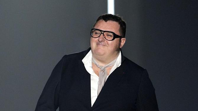 FILE - This July 1, 2012 file photo shows Israeli fashion designer Alber Elbaz at the end of the show for his  Men's Spring-Summer 2013 collection, for Lanvin fashion house in Paris, France.  Makeup powerhouse Lancome announced Monday, Jan. 14, 2013 that Elbaz will have a line of cosmetics,  Lancome x Alber Elbaz, launching in June. (AP Photo/Jacques Brinon, file)