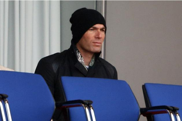 Real Madrid's assistant coach Zinedine Zidane watches as his son Enzo Alan Fernandez Zidane playing with Real Madrid's under 19 team during a UEFA youth league quarters final match against Par