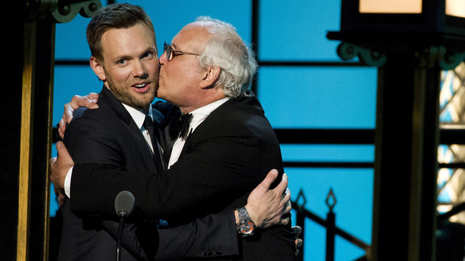 """In this April 28, 2012 photo, Joel McHale, left, and Chevy Chase from the NBC comedy series """"Community,"""" appear onstage at The 2012 Comedy Awards in New York. The Comedy Awards will air on Sunday, May 6 at 9:00 p.m. EST on Comedy Central. (AP Photo/Charles Sykes)"""