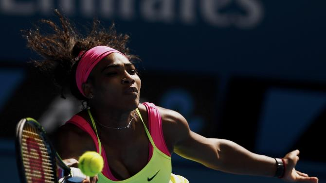 Williams of the U.S. stretches to hit a return to compatriot Keys during their women's singles semi-final match at the Australian Open 2015 tennis tournament in Melbourne