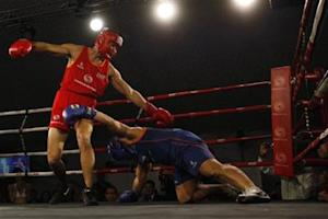 "Seth Chin fights against Juddy Temara during the ""Hedge Fund Fight Nite"" charity event in Hong Kong"