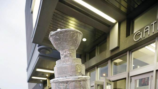 A fan dressed as Stanley Cup arrives at the United Center for Game 1 of the NHL Stanley Cup Final hockey series between the Chicago Blackhawks and the Boston Bruins, Wednesday, June 12, 2013, in Chicago. (AP Photo/Nam Y. Huh)
