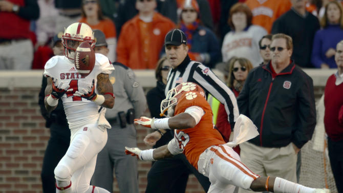 North Carolina State wide receiver Tobias Palmer, left, catches a pass for a touchdown while being covered by Clemson's CJ Jones during the first half of an NCAA college football game, Saturday, Nov. 17, 2012, in Clemson, S.C. (AP Photo/Richard Shiro)