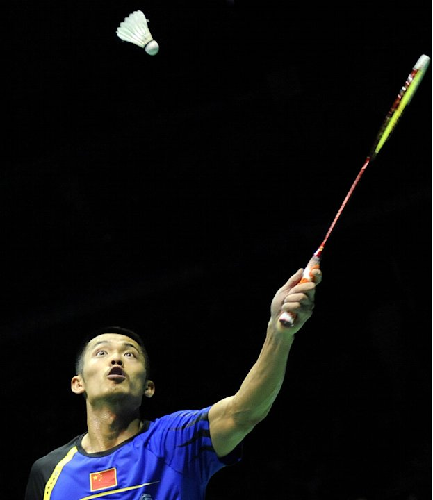 Lin Dan of China returns a shot against