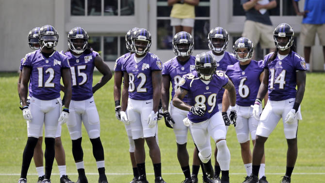 Baltimore Ravens receivers watch as wide receiver Steve Smith (89) runs a drill during NFL football practice, Wednesday, June 18, 2014, at the team's practice facility in Owings Mills, Md. (AP Photo/Patrick Semansky)