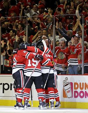 Chicago Blackhawks celebrate after right wing Patrick Kane scored a goal during the third period in Game 5 of the NHL hockey Stanley Cup playoffs Western Conference finals against the Los Angeles Kings, Saturday, June 8, 2013, in Chicago. (AP Photo/Nam Y. Huh)