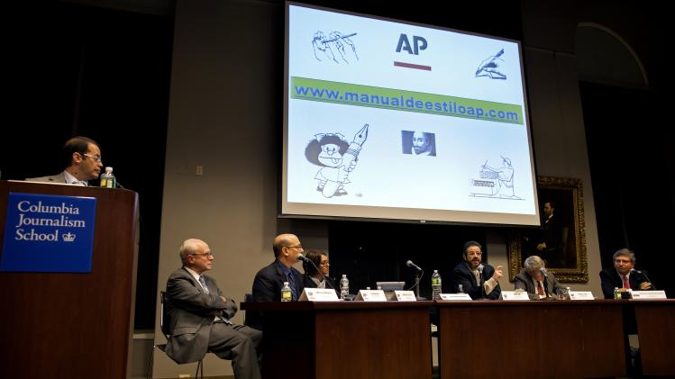 FILE -  This Monday, Nov. 19, 2012, file photo, moderator Alejandro Manrique, left, the Associated Press deputy editor for Latin America, and director of the AP Spanish Service, looks towards journalists gathered at Columbia University to discuss the launch of the Associated Press' first Spanish-Language stylebook, in New York. Members of the panel took questions and discussed why and how the stylebook was formulated. (AP Photo/Craig Ruttle, File)