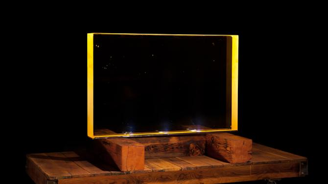 This undated photo provided by Bonhams shows a viewing window that shielded Manhattan Project scientists on the secret World War II bomb project from radiation. The 1,500 pound glass, measuring approximately 3 by 4 feet, contains 70 percent lead oxide and is among the items being offered for auction on Oct. 22, 2014 by Bonhams auction house in New York. (AP Photo/Bonhams)