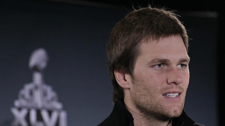 New England Patriots quarterback Tom Brady answers questions during a news conference on Wednesday, Feb. 1, 2012, in Indianapolis. The Patriots are scheduled to face the New York Giants in NFL football Super Bowl XLVI on Feb. 5. (AP Photo/Mark Humphrey)