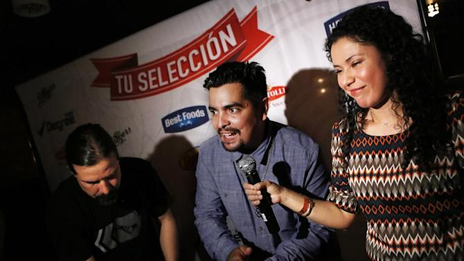 IMAGE DISTRIBUTED FOR UNILEVER - Chef Aaron Sanchez and Chef Ema Quevedo share quick and easy traditional Mexican recipes featured on the Tu Seleccion website to help families create the best home soccer viewing parties to celebrate their favorite teams during the Unilever Tu Seleccion launch party, Tuesday, March 26, 2013, in New York. Unilever is partnering with the Mexican National Team to celebrate two of the U.S Hispanic community's strongest passions - food and futbol. (John Minchillo/AP Images for Unilever)