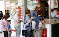 People are seen buying sandwiches at a local kebab reastaurant in Ankara. In Turkey, 35% of the population has accumulated excess body fat to the extent that it may have an adverse effect on health, leading to reduced life expectancy and/or increased health problems
