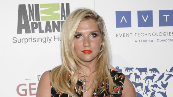 """FILE - This March 24, 2012 file photo shows singer Kesha at The 26th Annual Genesis Awards benefiting The Humane Society in Beverly Hills, Calif. The million-selling singer-songwriter has signed with Touchstone for the illustrated memoir """"My Crazy Beautiful Life,"""" scheduled to come out Nov. 20, shortly before her new album, """"Warrior.""""  (AP Photo/Dan Steinberg, file)"""