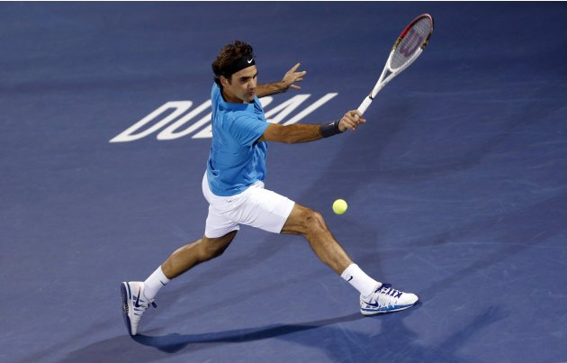 Federer of Switzerland hits a return to Berdych of Czech Republic during their men's singles semi-final match at the ATP Dubai Tennis Championships