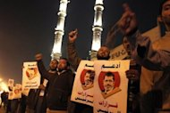 &lt;p&gt;Muslim Brotherhood members and supporters of Egyptian President Mohamed Morsi shout slogans in Cairo as they hold banners that read: &quot;support the decisions of the President&quot;. Rival mass protests have been called for next Tuesday in Egypt over a bitterly disputed constitutional referendum, raising the potential for more violent street clashes in a sharpening political crisis.&lt;/p&gt;