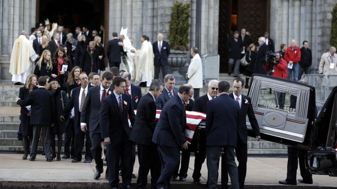 Pallbearers carry the casket containing the body of former St. Louis Cardinals baseball player Stan Musial out of the Cathedral Basilica of Saint Louis following his funeral Mass, Saturday, Jan. 26, 2013, in St. Louis. Musial, one of baseball's greatest hitters and a Hall of Famer with the Cardinals for more than two decades, died Saturday, Jan. 19, 2013. He was 92. (AP Photo/Jeff Roberson