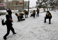 Syrian refugee children have a snowball fight at the mountain town of Bhamdoun, east of Beirut, Lebanon, Wednesday, Jan. 9, 2013. The fiercest winter storm to hit the Middle East in years has unleashed flash flooding, strong winds and a snowstorm that killed six people in the past few days, according to the Lebanese Red Cross. The Lebanese mountains have been covered with record snow fall that has brought traffic to a standstill and shut down mountain passes across the country. (AP Photo/Bilal Hussein)