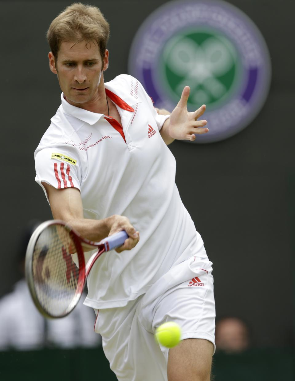 Florian Mayer of Germany plays a return to Novak Djokovic of Serbia during a quarterfinals match at the All England Lawn Tennis Championships at Wimbledon, England, Wednesday, July 4, 2012. (AP Photo/Kirsty Wigglesworth)