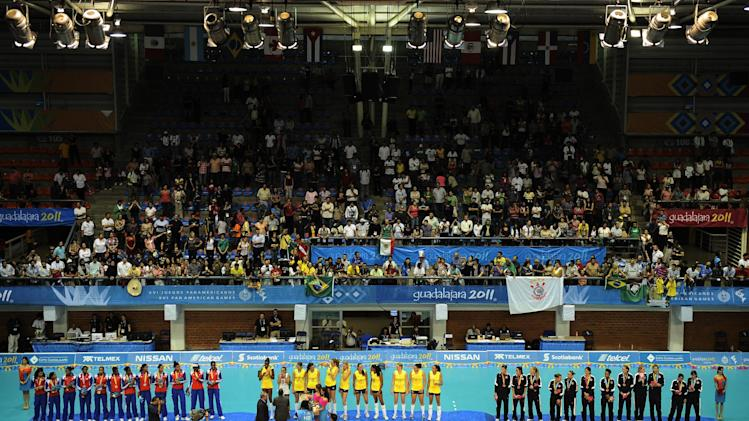 Gold medal winners Brazil´s players, center, silver medal winners Cuba's players, left, and bronze medal winners United States' players pose during the women's volleyball medal ceremony at the Pan American Games in Guadalajara, Mexico, Thursday, Oct. 20, 2011. (AP Photo/Daniel Ochoa de Olza)