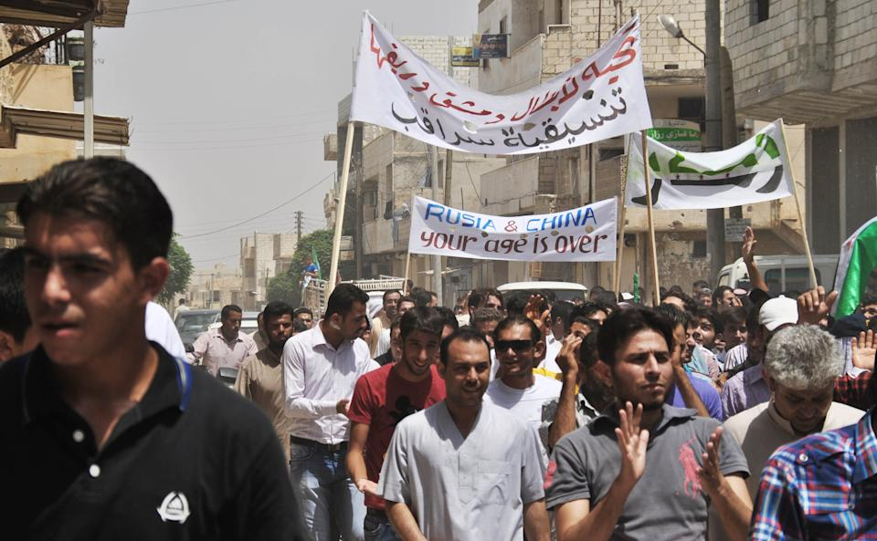 In this Friday, June 15, 2012 photo, Syrians chant slogans during a demonstration at Saraqeb town in Idlib, north Syria. (AP Photo/Fadi Zaidan)