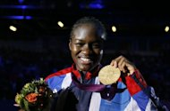 Nicola Adams of Great Britain celebrates her gold medal victory over Cancan Ren of China in the women's boxing Flyweight final of the 2012 London Olympic Games at the ExCel Arena in London. Adams won the first ever women's Olympic flyweight final with a 16-7 win over China's world champion Ren Cancan to claim the hosts' first boxing gold