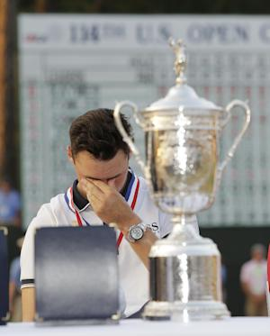 Martin Kaymer, of Germany, wipes his eyes behind the…