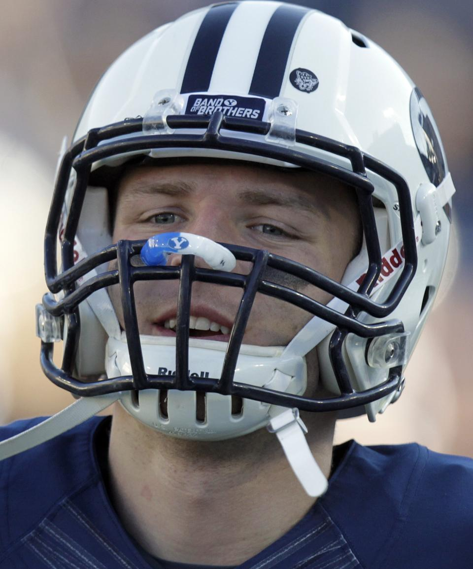 Brigham Young quarterback Taysom Hill looks on before the start of their NCAA college football game with Hawaii Friday, Sept. 28, 2012, in Provo, Utah.  BYU defeated Hawaii  47-0. (AP Photo/Rick Bowmer)