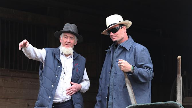 """This image released by DIY Network shows 90s recording artist Vanilla Ice, born Robert Van Winkle, is shown in the new series """"Vanilla Ice Goes Amish,"""" where Van Winkle learns from craftsmen.  Network executive Burton Jablin says the former rap star will live with an Amish community in Ohio to learn how they do construction. Vanilla Ice already has a renovation series on the network that will return for its fourth season this fall. (AP Photo/DIY Network.)"""