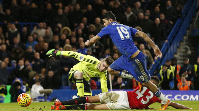 Chelsea's Diego Costa before scoring their first goal as Manchester United's David De Gea looks on