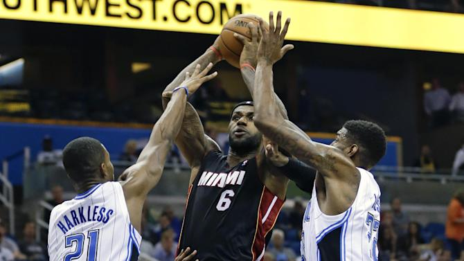 James scores 21, Heat roll past Magic 120-92