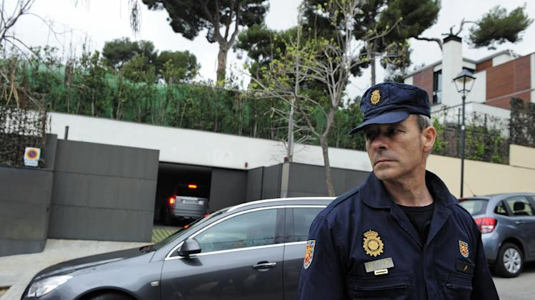 "A  police officer stands in front of the house of Spain's Princess Cristina and Inaki Urdangarin, the Duke of Palma, after Urdangarin drove into the garage  in Barcelona, Spain, Thursday, April 4, 2013. Spain's foreign minister said Thursday there was ""enormous concern"" within the government over the naming of one of the king's daughters as a suspect in a corruption case. A Spanish court has named the king's daughter Princess Cristina Wednesday April 3, 2013, as a suspect in an alleged corruption case involving her husband, and the court has announced that it will call her for questioning. (AP Photo/Manu Fernandez)"