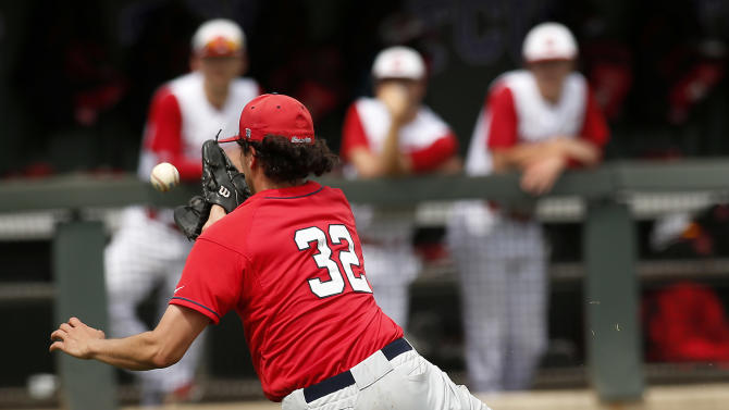 Stony Brook pitcher Daniel Zamora (32) makes a sliding catch on a bunted ball attempt by N.C. State's Josh McLain in the fifth inning at the Fort Worth Regional of the NCAA college baseball tournament  in Fort Worth, Texas, on Friday, May 29, 2015. N.C. State won 3-0. (AP Photo/Brad Loper)