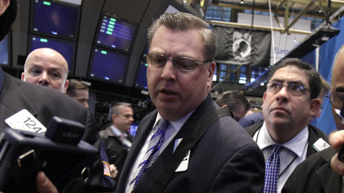 In this May 3, 2012, photo, trader Matthias Roberts, center, works on the floor of the New York Stock Exchange. Wall Street headed for a lower opening Friday May 11, 2012. Dow Jones industrial futures fell 0.4 percent to 12,780 and S&P 500 futures lost 0.4 percent to 1,351.70. (AP Photo/Richard Drew)