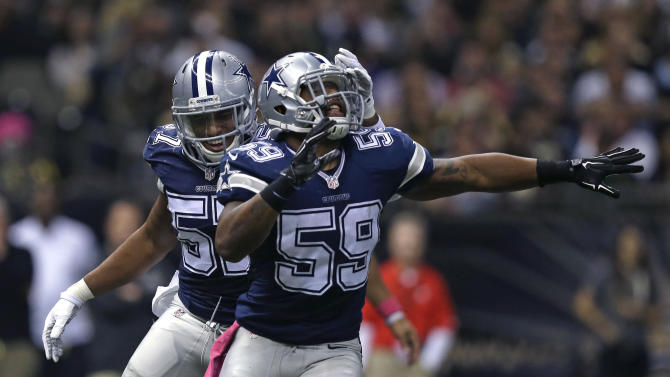 Dallas Cowboys middle linebacker Anthony Hitchens (59) celebrates after sacking New Orleans Saints quarterback Drew Brees in the first half of an NFL football game in New Orleans, Sunday, Oct. 4, 2015. (AP Photo/Brynn Anderson)