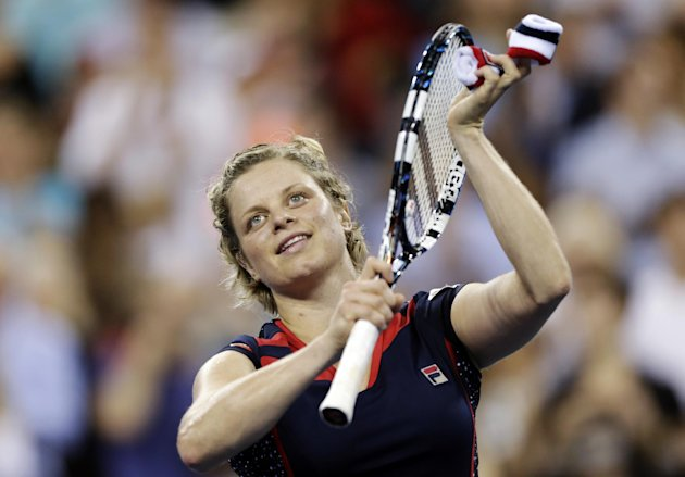 Kim Clijsters, of Belgium, thanks the crowd after defeating Victoria Duval 6-3, 6-1 in the first round of play at the U.S. Open tennis tournament, Monday, Aug. 27, 2012, in New York. (AP Photo/Charles Krupa)