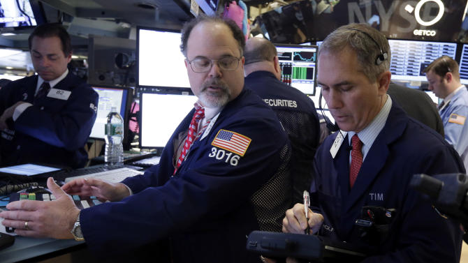 In this Friday, Jan. 25, 2013, photo, Specialist Douglas Johnson, left, and trader Timothy Nick work on the floor of the New York Stock Exchange. Some rare good economic news from Europe pushed world stock markets higher on Friday Feb. 1, 2013 as investors awaited a key U.S. employment report that is expected to show steady, if unremarkable, job growth.  (AP Photo/Richard Drew)