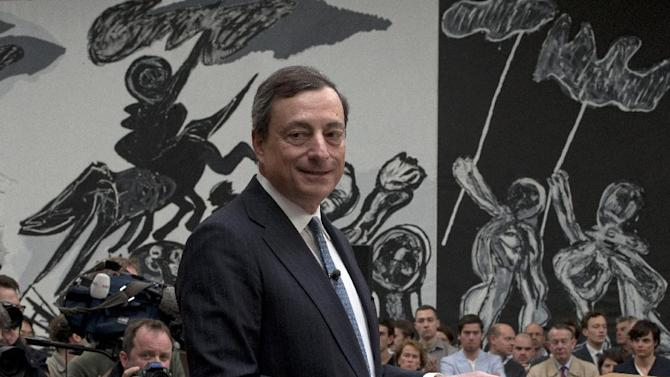 "A painting called ""The Madness of the Streets"" by Karel Appel is seen in the background as European Central Bank President Mario Draghi addresses students during a session of ""Room for Discussion"" at the Faculty of Economics of the UvA, or University of Amsterdam, Netherlands, Monday April 15, 2013. (AP Photo/Peter Dejong)"