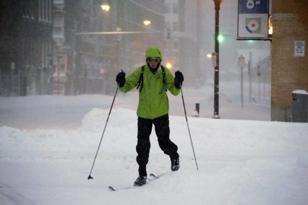 <p>               A pedestrian uses skis to travel through the deserted snow-covered streets of Boston early Saturday, Feb. 9, 2013. (AP Photo/Gene J. Puskar)