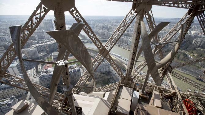 A view shows two 7-meter high vertical axis wind turbines installed on the second floor of the Eiffel tower in Paris