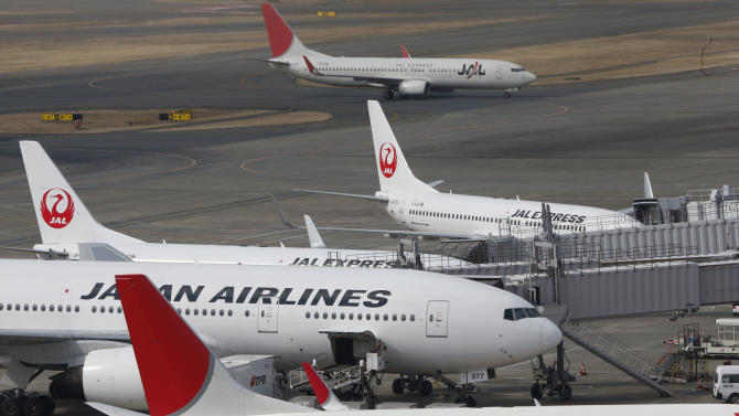 Japan Airlines passenger planes park at Haneda Airport in Tokyo, Monday, Feb. 4, 2013.  Japan Airlines, which made a comeback from bankruptcy, says its net profit fell 3.7 percent in the first three quarters of 2012, but the carrier shrugged off the impact from its grounded 787s, raising its full-year profit estimate. (AP Photo/Koji Sasahara)