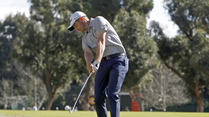 John Merrick makes his second shot on the second fairway in the third round of the Northern Trust Open golf tournament at Riviera Country Club in the Pacific Palisades area of Los Angeles Saturday, Feb. 16, 2013. (AP Photo/Reed Saxon)