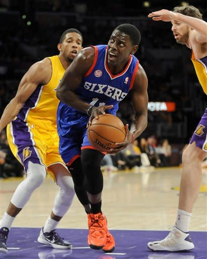 Holiday leads Sixers over Lakers 103-99