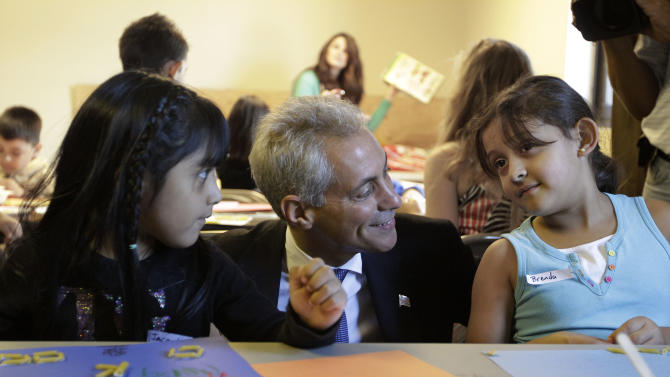 Chicago Mayor Rahm Emanuel visits with students Jacquelina Mena, left, and Brenda Pena at Maranatha Church in Chicago, Monday, Sept. 10, 2012, where students were being provided structured activities in their community and safe environment during a teachers strike. Thousands of Chicago Public School teachers walked off the job Monday in the nation's third-largest school district for the first time in 25 years after union leaders announced they were far from resolving a contract dispute with school district officials. (AP Photo/M. Spencer Green)